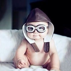 Seriously cute photo of a baby in an old pilots hat and goggles. Ahdorable!