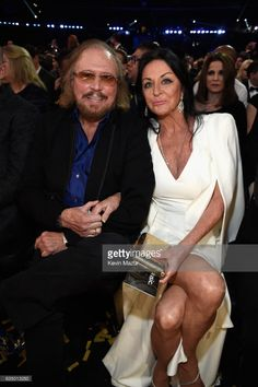Singer-songwriter Barry Gibb of the Bee Gees and Linda Gray attend The 59th GRAMMY Awards at STAPLES Center on February 12, 2017 in Los Angeles, California.