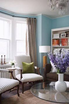 brown couch, blue {ish} walls, khaki drapes
