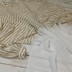 Open Knit Banana lemon Knit Tan/ white open knit. Waffle white tan blended top  Sheer white flowing bottom  Cuffed 3/4 sleeve  Size 1XL fits  Polyester spandex mix NWOT   33' armpit to armpit  30' length Sweaters Cardigans