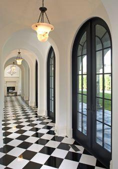 Black & White stunning Hallway love the doors hate checker board