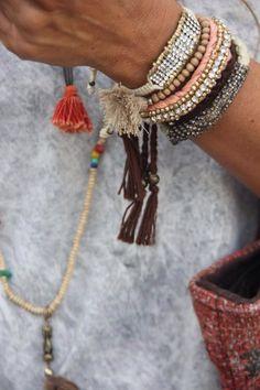 Stacked bracelets.