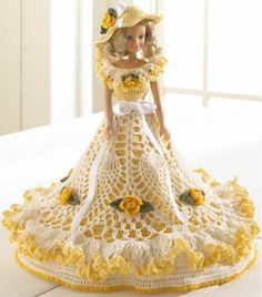 The name Gabriela means - devoted to God. What better name for this gorgeous doll! This beautiful pineapple dress is accented with delicate gold roses, flowing ruffles and satin ribbon.