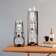 Elegant Slow-Brew Coffee Makers - by Dutch Lab developed this idea to cut down the time needed for slow-brewed coffee use cold water for less acidic results and remove the need for electricityand their innovative experimentation has been a success: each Dutch Lab machine has three vertically aligned glass flasks that the water drips through to make aromatic coffee. #DripCoffeeMakerBrewing