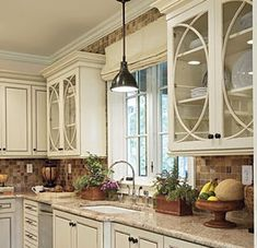 backsplash, white cabinets, roman shade and light for over sink