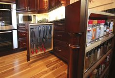 Double hidden slide-out #columns. Perfect #storage for #Kitchen tools and #spices