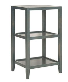Sleek-looking and handsome, this compact bookcase offers a modern take on distressed furniture. It works as a functional nightstand or side table thanks to the open shelves.