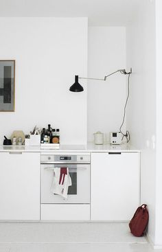 all white and compact kitchen - hipster apartments