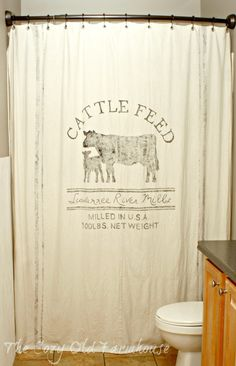 Custom Made Feed Sack Canvas Shower Curtain by TheCozyOldFarmhouse -Down the road Ben will hopefully have an idea what he wants to call his cattle company along with a symbol. I can't wait to make one for our bathroom!