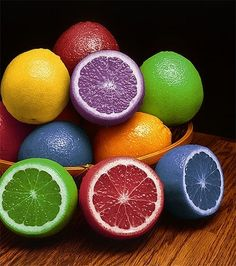 Inject food coloring in lemons- serve with water or in dishes to fit color theme of event - cool idea for a grown up party