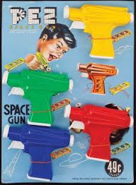 Toy guns that shoot Pez... what could go wrong? LOL  I still have my green one :)