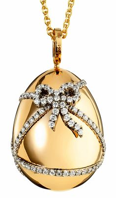 Fabergé. Oeuf Cadeau. 18 carat rose gold and features white round diamonds. The egg pendant is 22mm in height. POA