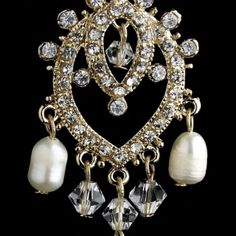 "A lovely classic inspired gold plated chandelier earrings that features clear rhinestones and fresh water pearls that dangle beautifully. These earrings are absolutely radiant and make the perfect accessory to your classic or modern inspired wedding.  Size: 2.25"" (Length) 1"" (Width)"
