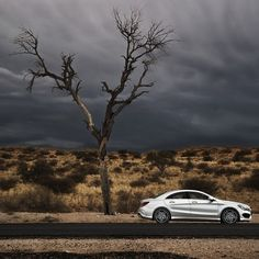 The CLA45 AMG resting under a Kalahari Tree and ominous skies in South Africa…