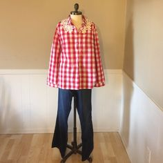 Gorgeous Red Checkered Top Beautiful Checkered Top that is button up! Has beautiful knit design on back!!                            ❤️ Prices are negotiable but please be considerate due to Poshmark fees are 20% ❤️ OFFER button is always the best ❤️ Bundles receive great discounts ❤️ SAME day shipping ❤️ No Trades, No holds , No PayPal  ❤️ Happy Poshing  Tops Button Down Shirts