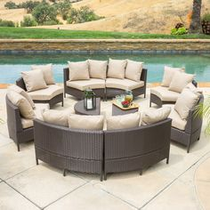 Constructed from wicker, a durable material thats fitting for the outdoors, this set includes eight round two-seater sofas that fit together to create a full circle shaped lounge with two matching ottomans that can be nestled within the lounge.