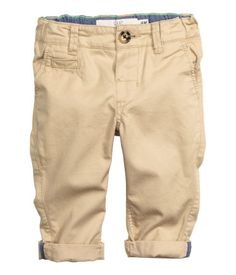 Chinos in cotton twill. Side pockets, mock back pocket, adjustable elasticized waistband, and mock fly with button.