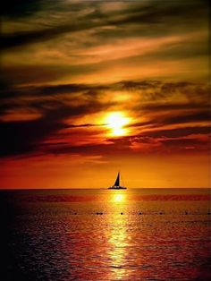 Picture perfect sail boat & Jamaica sunset at Couples Resorts.