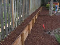 long raised bed- great way to go vertical along fenceline property in back yard.  Add color and/or veggies.
