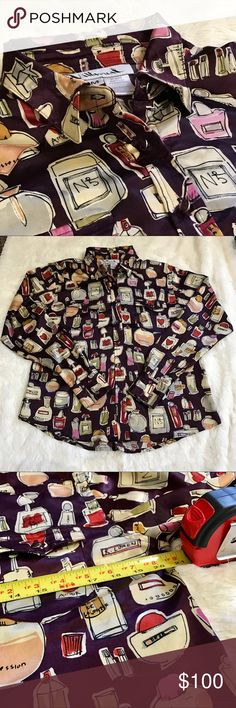 💖Rare Unique Villarreal Perfume Bottle Blouse 💖Rare Unique Villarreal Perfume Bottle Blouse  Material: 100% Polyester   Size: M   It features 2 front functional pockets, 2 buttons at the wrists, and purple jewel buttons.  The background color is purple.    Arm pit to arm pit measurements are shown in the photo.   ❌No Trades. Villarreal Tops Button Down Shirts