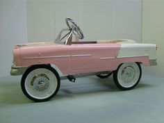 sweet ride:)  OMG! This is WAY cuter than those plastic battery powered cars the kids have today!
