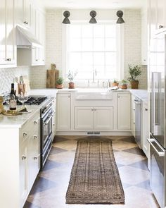 kitchen Lauren Liess Habitat harlequin cork floors, tumbled marble walls