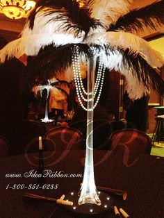 Old Hollywood guest table centerpieces? love how it seems to symbolize/resemble a slender woman wearing a feather hat and pearls! old-hollywood-babyshower Ostrich Feather Centerpieces, Pearl Centerpiece, Candle Centerpieces, Wedding Centerpieces, Peacock Centerpieces, Old Hollywood Prom, Hollywood Wedding, Hollywood Theme, Gatsby Wedding
