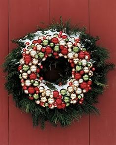 •❈• Holiday wreath   Great idea to take 2 wreaths and layer them.  The evergreen is a great backdrop for the Christmas bulb wreath.  On the bulbs here, it is great that she tied the color into the color of her door.
