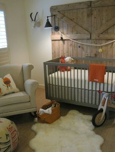 Loving the paper mache antelope from Anthtopologie and the gray sparrow crib from Oeuf