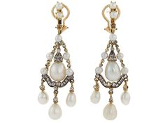 Antique Victorian Natural Pearl, Cultured Pearl and Diamond Earrings in Silver and Gold, ca. 1850, Crafted in silver and gold, the chandelier design features antique rose-cut diamonds contrasted with sumptuous pearls. The tops of these earrings were added during the mid twentieth century. The four largest pearls on each earring were tested and certified by the GIA. Six of the pearls graded as natural, while two of the smaller pearls graded as cultured.