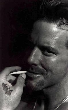 The original Mickey Rourke before he ruined his face with botched surgery.
