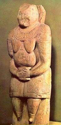 """""""Stone Baba (Woman). Krasnodar Region. 11th-12th centuries. Limestone. H 165 cm. Provide us with important information about the appearance and clothing of the nomads of the south Russian steppes. This is a canonical work – a frontal representation of the body with a traditional attribute, a goblet, in the hands, with detailed indication of rich clothing and ornaments. Set up on a natural mound or the top of a barrow and dedicated to ancestor-heroes. Various ritual feasts took place near…"""
