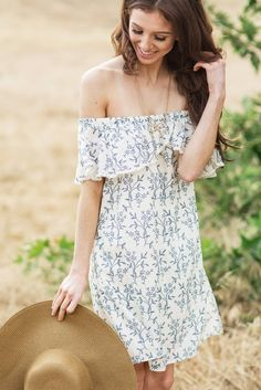 Off the shoulder dresses are our guilty pleasure! We love the dainty floral print of this dress and the ruffle...