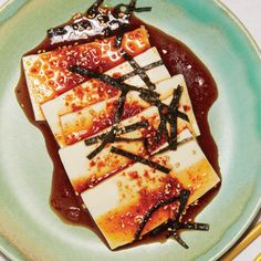 Chilled Tofu with Soy Dressing   This Chilled Tofu with Soy Dressing recipe gets its flavor from nutty sesame oil, creamy silken tofu, and spicy Korean red pepper flakes. Get the recipe from Food & Wine.