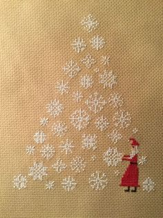 completed cross stitch Prairie Schooler Christmas Tree with snowflakes