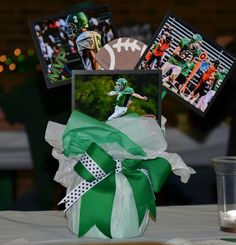 The base was a roll of toilet paper, with floral foam in the… Sports Banquet Centerpieces, Banquet Decorations, Party Centerpieces, Banquet Ideas, Centrepieces, Cheer Banquet, Football Banquet, Tissue Paper Centerpieces, Senior Gifts