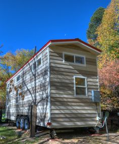 The exterior of this tiny house uses two-tone cedar lap siding for a more traditional look.