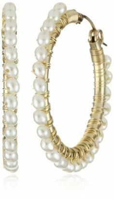 "Viv ""Wrap"" 14k Gold Fill 1.25"" White Pearl Hoop Earrings Viv $132.00. Made in United States. Each Viv & Ingrid signature wrap hoop is wire wrapped by hand in our Berkeley, CA studio. Every pair comes with our signature fabric jewelry pouch!. Store in our fabric jewelry pouch to protect from tarnishing. Pearls are freshwater white pearls, which may naturally vary in size and color"
