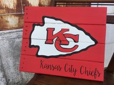 KC football chiefs man cave decor chiefs by RepurposedByStephens Kc Football, Football Crafts, Football Decor, Chiefs Logo, Kansas City Chiefs Football, Pallet Art, Pallet Signs, Fence Signs, Wood Signs