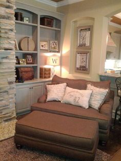 overstuffed chair- so comfy. Love the colors in this room and the stone on the fireplace