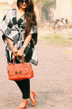 monochrome cape with tangerine bag and heels