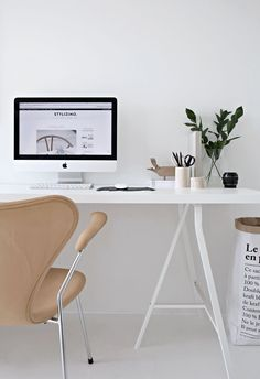 A new look in the office- white office! Beautiful minimal home office spaces and home organisation. Create an inspiring space to work from home, or study at home. Re-pin for someone you know!