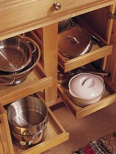 Base Roll-Out Trays - traditional - kitchen cabinets - other metro - Merillat would narrower pull outs be easier to keep the pans organized than the wider pull outs?