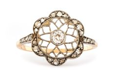 Lakeville is a gorgeous vintage Edwardian ring featuring a hand pierced starburst design enhanced with delicate milgraining that encircles the center diamond. A floral halo studied with Rose Cut diamonds finishes off this gorgeous, unique ring from T & H. TrumpetandHorn.com | $3,100