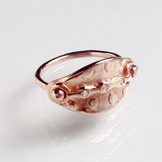 Badass and elegant Armor Style ring in rose gold with diamonds.  by: camille hempel design