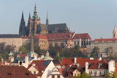 Prague Castle amidst rooftops - Prague, Czech Republic