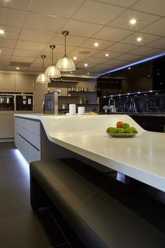 Siematic centre kitchen island with curved worktop and seated breakfast area. Kitchen completed with Siemens ovens, hob, and extractor. Spillers of Chard