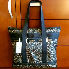 69✂LeSportsac Cheetah Print Tote3xHP PRICE IS FIRM!! (Seeon TITLE) This is the lowest I can do!! Make me an offer, it's YOURS! ➖➖➖➖➖➖➖➖➖➖➖➖➖  ✨N-W-T✨ Never been used before  ⏩Exotic cheetah print lends a dose of glamour to lesportsac's signature nylon construction on this spacious, travel-friendly tote.  ⏩Top double zip closure, lined.  ⏩Three exterior zip pockets, one interior zip pocket.   ⏩So practical and functional with strong, durable, waterproof & easy care material  Size…