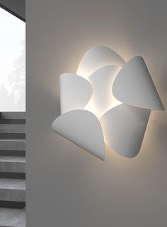 Lotus Wall Light features a radial arrangement of whisper-like petals, like the arching streams of a fountain, catch the light from a semi spherical reflector over the core, casting a dramatic array of hairline shadows on a surface. Available in Textured White. One 9 watt LED module is included. Dimmable with a standard incandescent or low voltage electronic dimmer. ETL listed. 12.5 inch width x 12.5 inch height x 6.5 inch depth. Commercial Office Design, Led Module, Light Of My Life, Bright Lights, Flower Petals, Christians, Whisper, Industrial Design, Design Projects