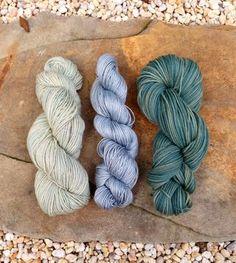 Dyeing with blackbeans. Non-superwash wool, bamboo silk blend, superwash merino respectively.